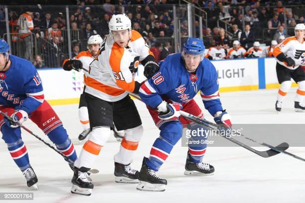 T Miller of the New York Rangers skates against Valtteri Filppula of the Philadelphia Flyers at Madison Square Garden on February 18 2018 in New York...