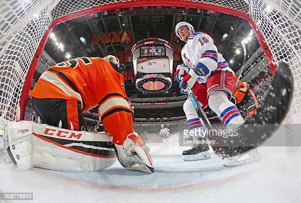 T Miller of the New York Rangers skates into the crease of Steve Mason of the Philadelphia Flyers on February 6 2016 at the Wells Fargo Center in...