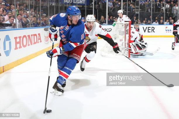 T Miller of the New York Rangers skates with the puck against Cody Ceci of the Ottawa Senators in Game Three of the Eastern Conference Second Round...