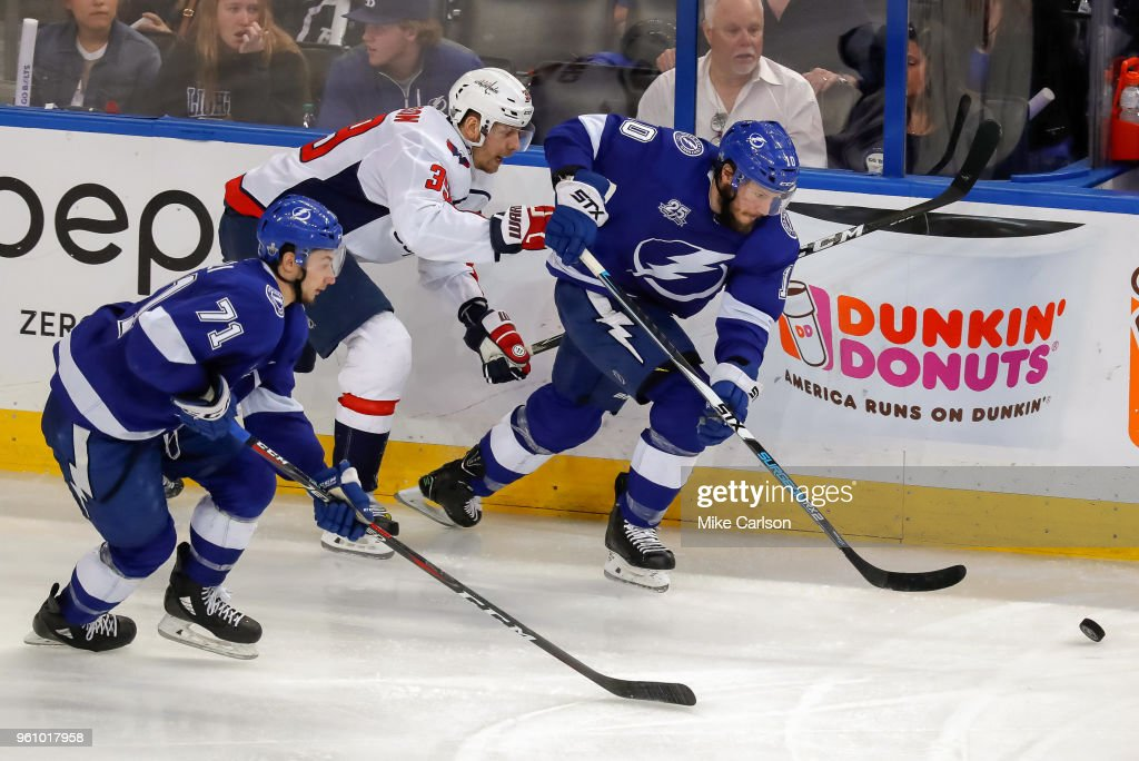 J.T. Miller #10 of the Tampa Bay Lightning and Anthony Cirelli #71 move the puck against Alex Chiasson #39 of the Washington Capitals during the third period in Game Five of the Eastern Conference Finals during the 2018 NHL Stanley Cup Playoffs at Amalie Arena on May 19, 2018 in Tampa, Florida.. (Photo by Mike Carlson/Getty Images) Alex Chiasson;J.T. Miller;Anthony Cirelli