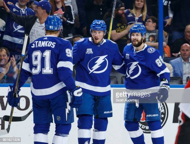 T Miller of the Tampa Bay Lightning celebrates his goal with teammates Steven Stamkos and Nikita Kucherov and against the Ottawa Senators during the...