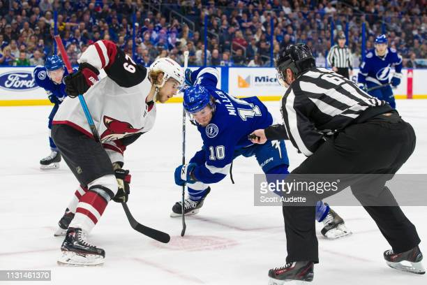 T Miller of the Tampa Bay Lightning faces off against Mario Kempe of the Arizona Coyotes in the first period at Amalie Arena on March 18 2019 in...