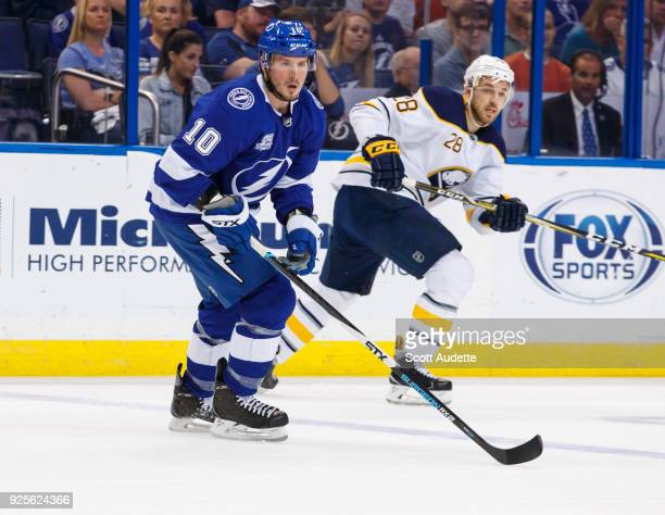 T Miller of the Tampa Bay Lightning skates against Zemgus Girgensons of the Buffalo Sabres during the first period at Amalie Arena on February 28...