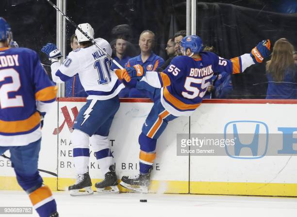 T Miller of the Tampa Bay Lightning steps into Johnny Boychuk of the New York Islanders during the first period at the Barclays Center on March 22...