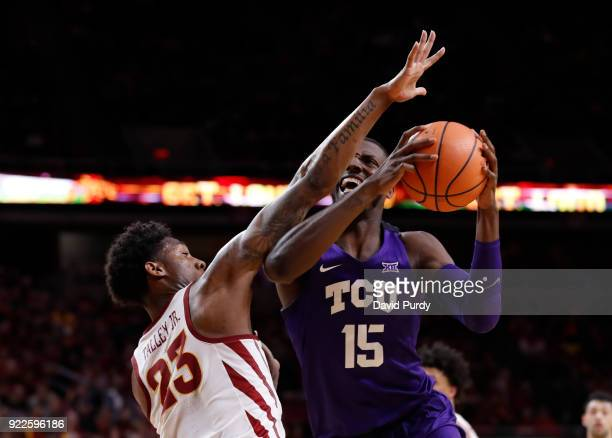 Miller of the TCU Horned Frogs goes up for a shot as Zoran Talley Jr #23 of the Iowa State Cyclones defends in the second half of play at Hilton...