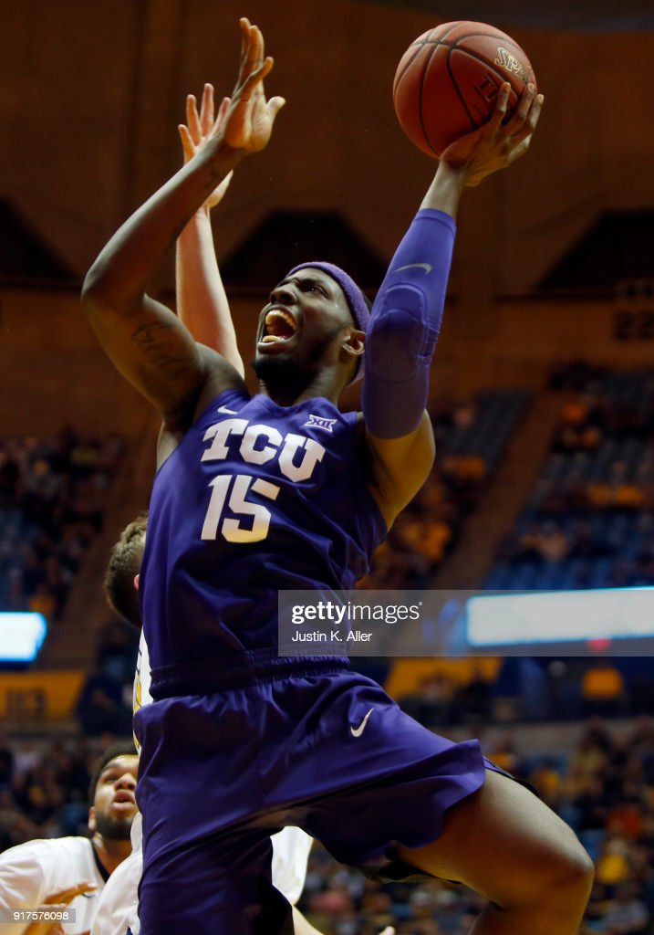 JD Miller #15 of the TCU Horned Frogs takes a shot against the West Virginia Mountaineers at the WVU Coliseum on February 12, 2018 in Morgantown, West Virginia.