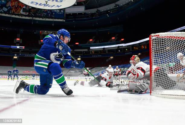 Miller of the Vancouver Canucks scores on Marcus Hogberg of the Ottawa Senators during their NHL game at Rogers Arena on January 27, 2021 in...