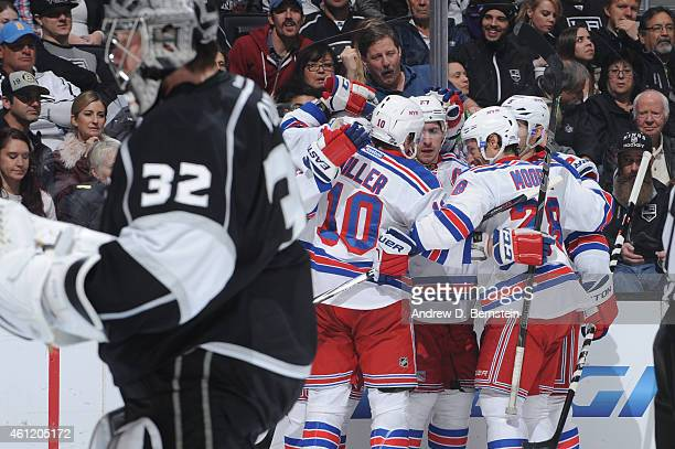 T Miller Ryan McDonagh Dominic Moore and Dan Girardi of the New York Rangers celebrate as Jonathan Quick of the Los Angeles Kings looks on at STAPLES...