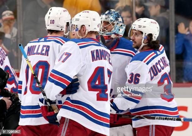 T Miller Steven Kampfer and Mats Zuccarello of the New York Rangers congratulate goaltender Henrik Lundqvist following a 31 victory over the Winnipeg...