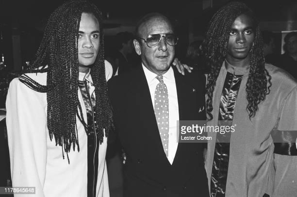 Milli Vanilli and Clive Davis attend a party circa 1989