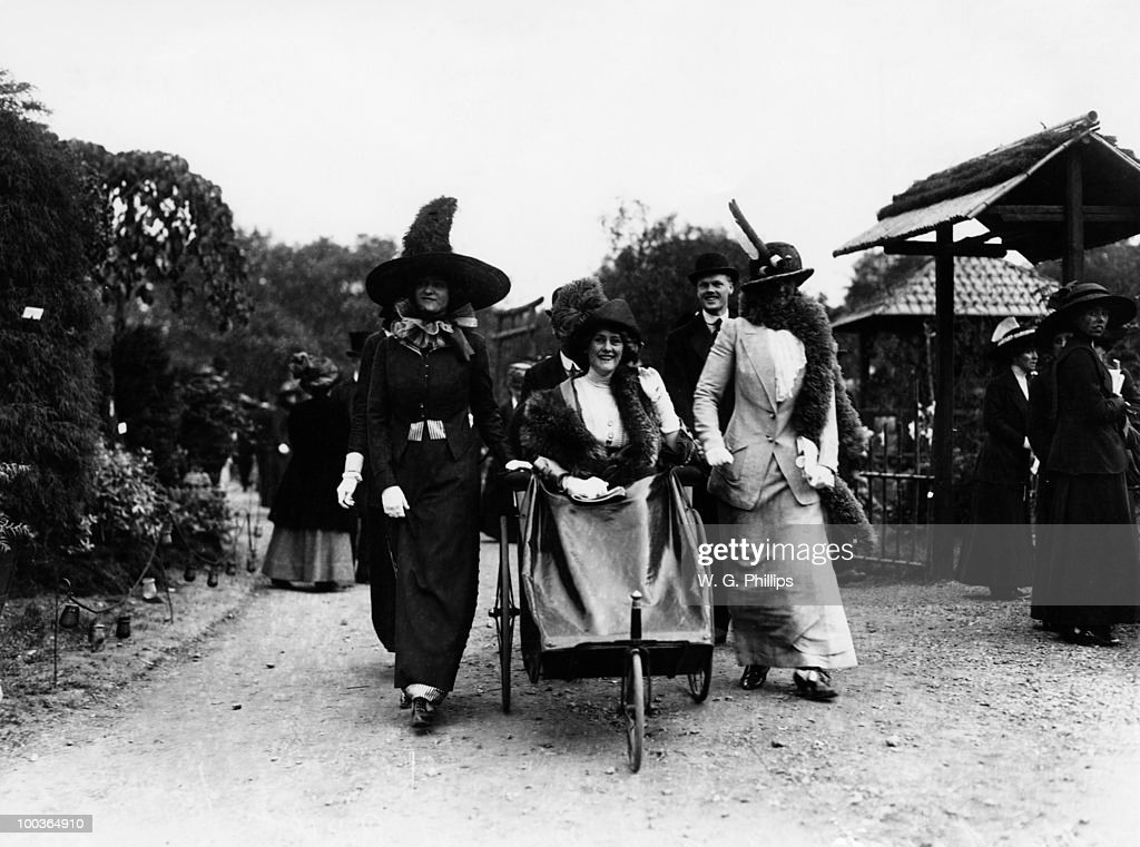 Millicent Leveson-Gower, Duchess of Sutherland (1867 - 1955, left ) with her daughter Lady Rosemary Sutherland-Leveson-Gower (1893�1930, right), at the Chelsea Flower Show, London, May 1912. Between them, in the bath chair is Lady Mary Stanley.