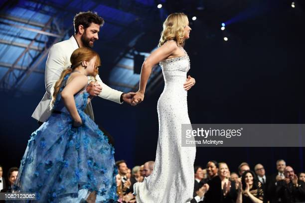 Millicent Simmonds John Krasinski and Emily Blunt walk onstage to accept Best SciFi/Horror Movie for 'A Quiet Place' at the 24th annual Critics'...