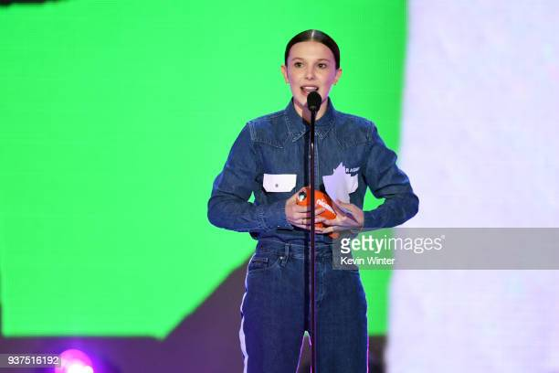 Millie Bobby Brown accepts the Favorite TV Actress award for 'Stranger Things' onstage at Nickelodeon's 2018 Kids' Choice Awards at The Forum on...
