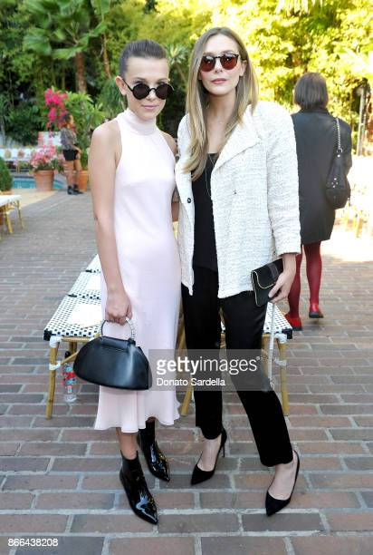 Millie Bobby Brown and Elizabeth Olsen attend CFDA/Vogue Fashion Fund Show and Tea at Chateau Marmont at Chateau Marmont on October 25 2017 in Los...