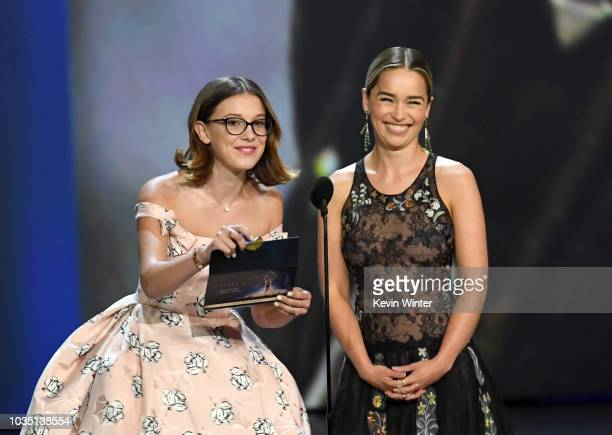 Millie Bobby Brown and Emilia Clarke speak onstage during the 70th Emmy Awards at Microsoft Theater on September 17 2018 in Los Angeles California