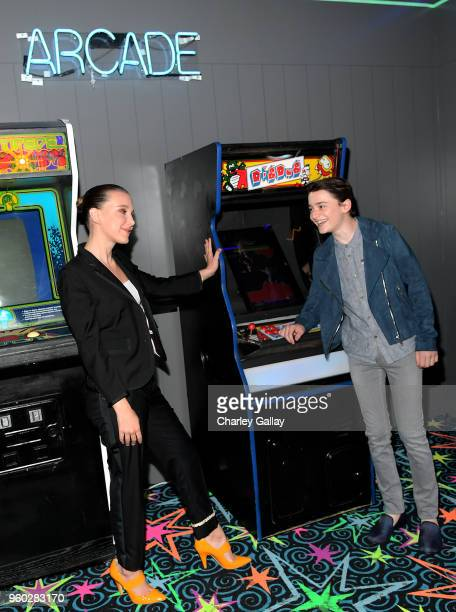 Millie Bobby Brown and Noah Schnapp attend The 'Stranger Things 2' Panel At Netflix FYSEE on May 19 2018 in Los Angeles California
