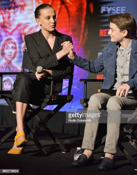 Millie Bobby Brown and Noah Schnapp speak on stage at #NETFLIXFYSEE event for Stranger Things at Netflix FYSEE at Raleigh Studios on May 19 2018 in...
