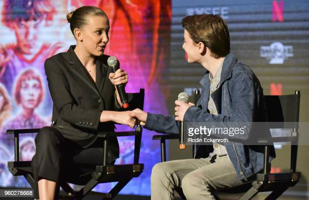 Millie Bobby Brown and Noah Schnapp speak on stage at #NETFLIXFYSEE event for 'Stranger Things' at Netflix FYSEE at Raleigh Studios on May 19 2018 in...