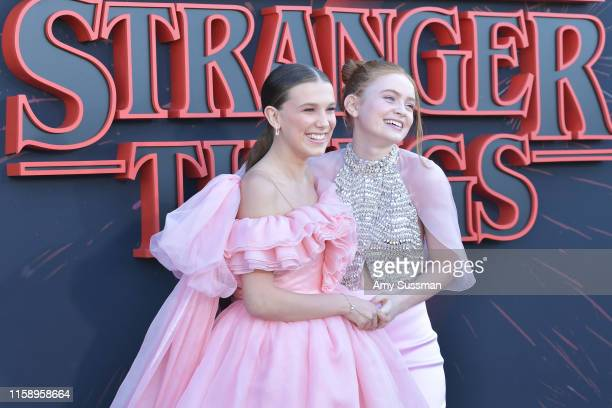 Millie Bobby Brown and Sadie Sink attend the premiere of Netflix's Stranger Things Season 3 on June 28 2019 in Santa Monica California