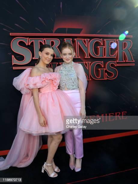 "Millie Bobby Brown and Sadie Sink attend the ""Stranger Things"" Season 3 World Premiere on June 28, 2019 in Santa Monica, California."