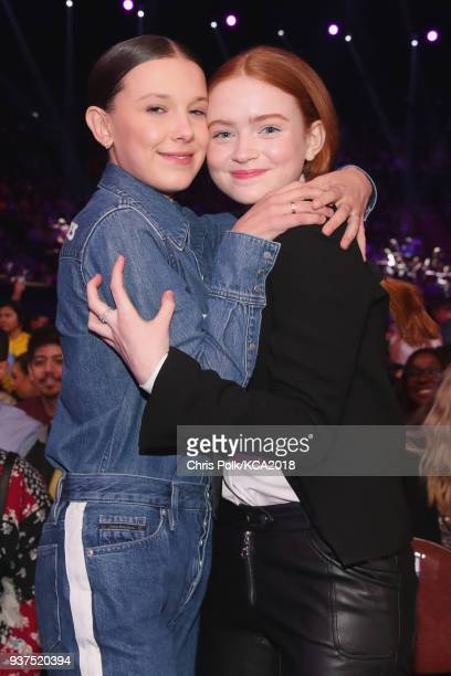 Millie Bobby Brown and Sadie Sink onstage at Nickelodeon's 2018 Kids' Choice Awards at The Forum on March 24 2018 in Inglewood California