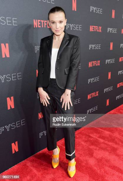 Millie Bobby Brown arrives at the #NETFLIXFYSEE event for 'Stranger Things' at Netflix FYSEE at Raleigh Studios on May 19 2018 in Los Angeles...