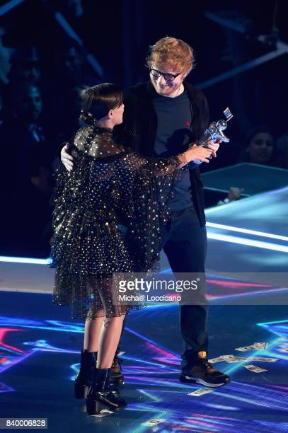 Millie Bobby Brown presents the Artist of the Year award to Ed Sheeran onstage during the 2017 MTV Video Music Awards at The Forum on August 27 2017...