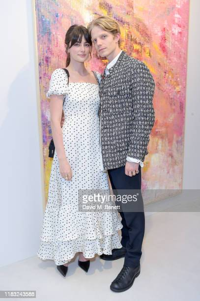 Millie Brady and Charley Palmer Rothwell attend a private view of EXTREMIS by Sassan BehnamBakhtiar on October 24 2019 in Dusseldorf Germany