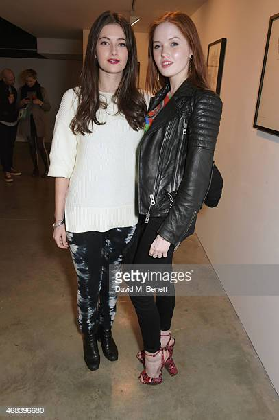 Millie Brady and Ellie Bamber attend a private view of 'The Top Ten' by artist Hayden Kays at The Cob Gallery on April 2 2015 in London England