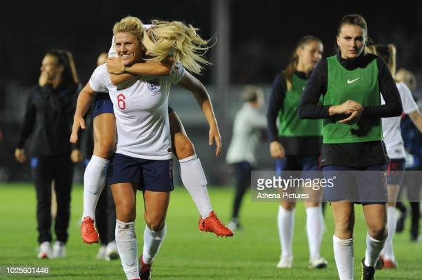 Millie Bright celebrates with Rachel Daly of England Women at the final whistle of the FIFA Women's World Cup Qualifier match between Wales and...