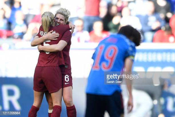 Millie Bright hugs Steph Houghton of England during the second half against Japan in the SheBelieves Cup at Red Bull Arena on March 08 2020 in...