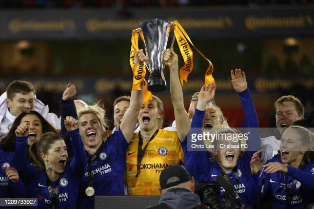 Millie Bright of Chelsea AnnKatrin Berger of Chelsea and Magdalena Eriksson of Chelsea lift the Continental Cup during the FA Women's Continental...