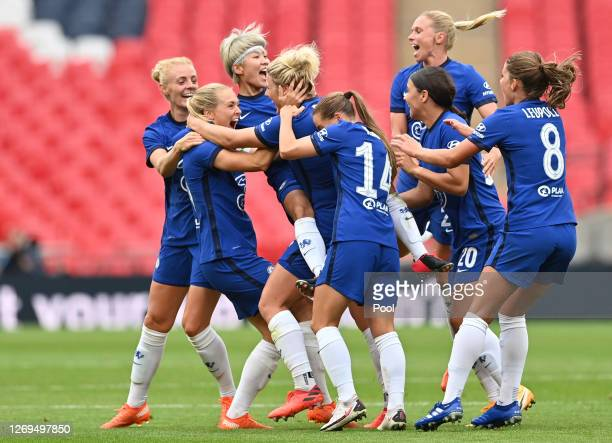 Millie Bright of Chelsea celebrates with teammates after scoring her team's first goal during the Women's FA Community Shield Final at Wembley...