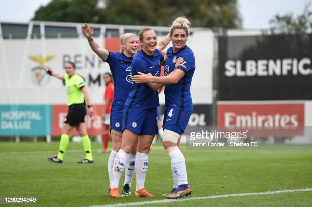 Millie Bright of Chelsea celebrates with teammates Bethany England and Magdalena Eriksson after scoring her team's second goal during the UEFA...