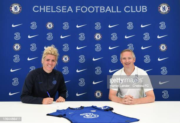 Millie Bright of Chelsea poses for a photograph with Paul Green Assistant Manager of Chelsea as she signs a new contract with Chelsea FC Women at...