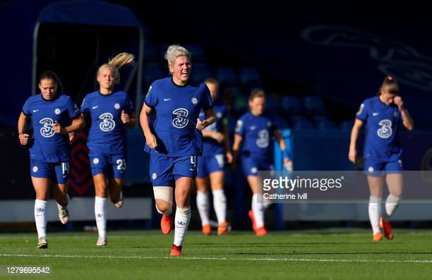Millie Bright of Chelsea runs out with her team mates at the start of the secondd half during the Barclays FA Women's Super League match between...
