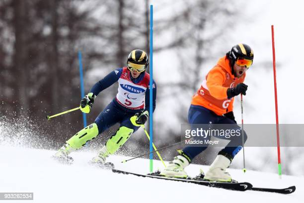 Millie Knight of Great Britain and her guide Brett Wild compete in the Women's Visually Impaired Slalom at Jeongseon Alpine Centre on Day 9 of the...