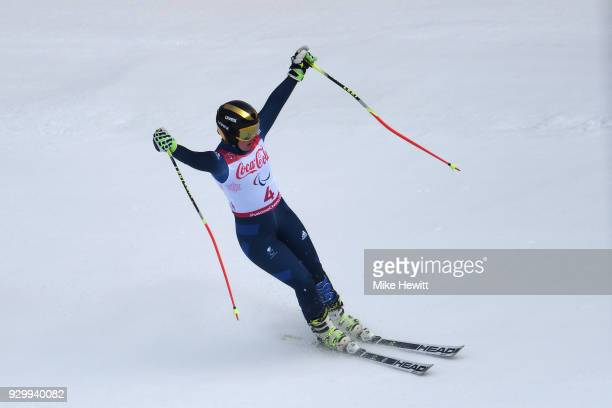 Millie Knight of Great Britain celebrates after finishing 2nd in the Visually Impaired Women's Downhill during day one of the PyeongChang 2018...