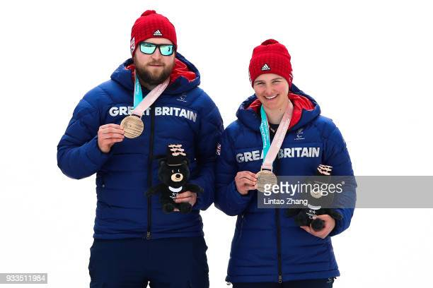 Millie Knight of Great Britain right and her guide Brett Wild celebrate with their bronze medals in the Women's Visually Impaired Slalom at Jeongseon...