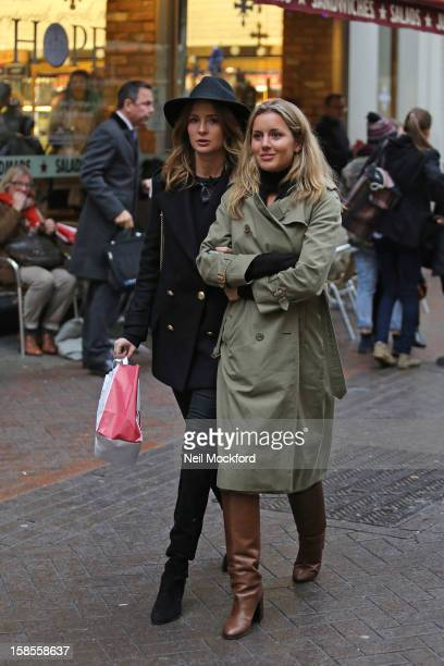 Millie Mackintosh and Caggie Dunlop seen filming on Carnaby St on December 19 2012 in London England