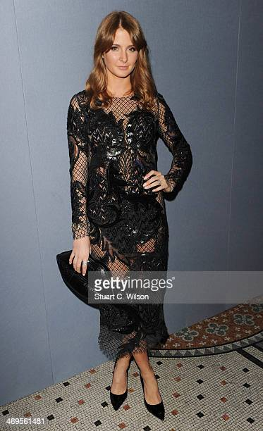 Millie Mackintosh attends the Julien Macdonald show at London Fashion Week AW14 at Royal Courts of Justice Strand on February 15 2014 in London...