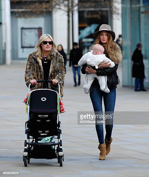 Millie Mackintosh of 'Made in Chelsea' is seen carrying a friends baby on March 14 2013 in London United Kingdom