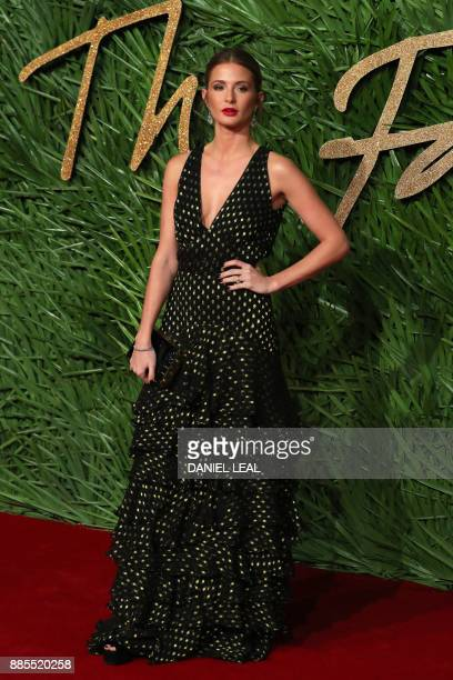 Millie Mackintosh poses on the red carpet upon arrival to attend the British Fashion Awards 2017 in London on December 4 2017 / AFP PHOTO / DANIEL...