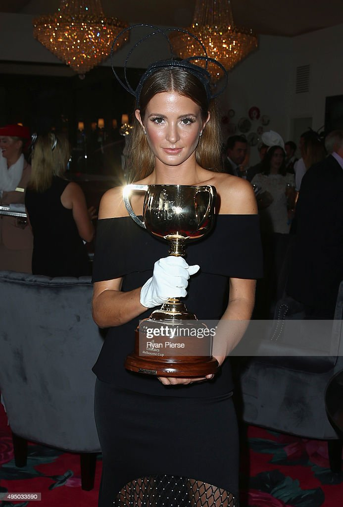 Millie Mackintosh poses with the Melbourne Cup at the Emirates Marquee on Derby Day at Flemington Racecourse on October 31, 2015 in Melbourne, Australia.