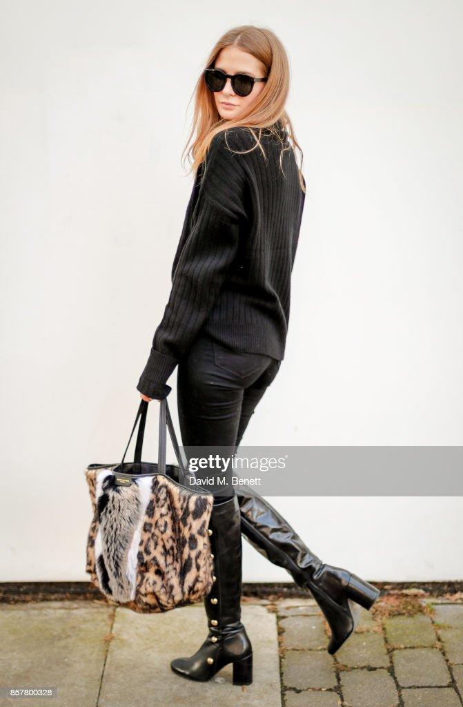 Millie Mackintosh wearing Kurt Geiger boots and carrying a Kurt Geiger bag on October 5, 2017 in London, England.