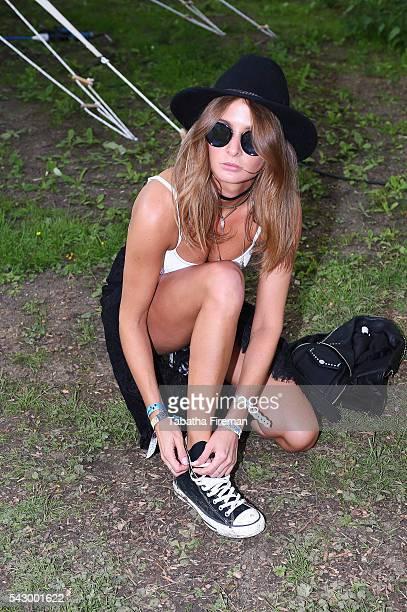 Millie Mackintosh wears Converse at Glastonbury Festival 2016 at Glastonbury Festival Site on June 25 2016 in Glastonbury England