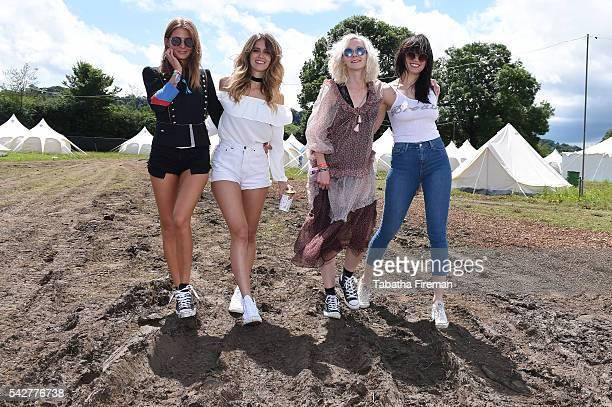 Millie Mackintosh Whinnie Williams Portia Freeman and Daisy Lowe wear Converse at Glastonbury Festival 2016 at Glastonbury Festival Site on June 24...