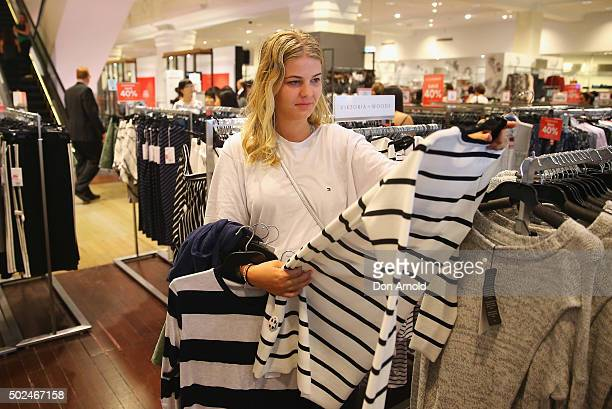 Millie Oaks from Melbourne inspects mechandise inside the David Jones Castlereagh St store during the Boxing Day sales on December 26 2015 in Sydney...