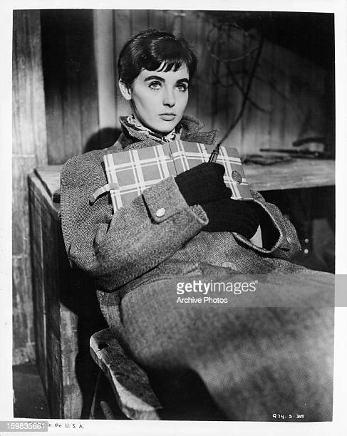 Millie Perkins holding diary in a scene from the film 'The Diary Of Anne Frank' 1959