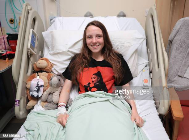 Millie Robson from Co Durham wearing Arianna Grande tshirt a victim of Manchester Arena bombing as Queen Elizabeth II visits the Royal Manchester...